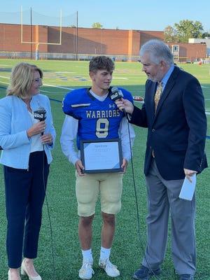 "State Sen. Pam Helming, R-54th District, presents Spectrum News' Scholar Athlete of the Week Award to Webster Schroeder football player Jonathan ""Jonny"" Maier."