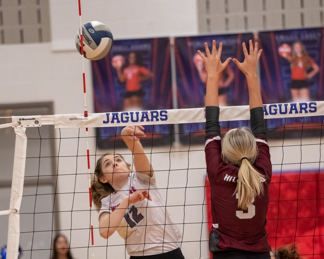 Heritage senior Kensey Clifton (12) goes on the attack during Friday evening's home match against Hillsboro. Clifton, a setter, recorded her 1,000th career assist in the Jaguars' sweep.