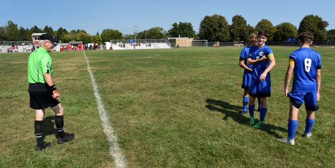 """Raymond Kuhr of Taylor begins to referee the match between Monroe and Carlson varsity soccer recently by himself on September 18, 2021. """"I just got back from vacation last night and was asked for me to referee today,"""" said Kuhr. Kuhr had to have two junior varsity players watch the sidelines for out of bound play."""