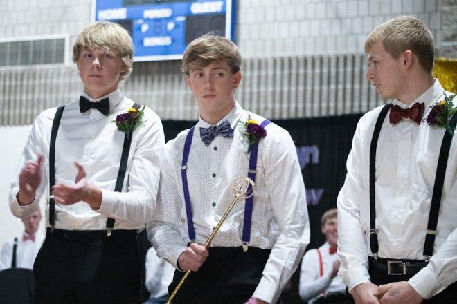 Skyler Schwendemann and Bradyn Schultz look on as Andrew VanBinsbergen is crowned Homecoming Prince.