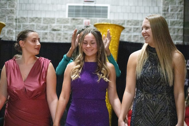 Keely Foley and Amery Arends look on as Emily Brace is crowned Homecoming Princess.