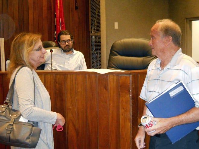 Christine Michaels, president and CEO of the Oak Ridge Chamber of Commerce, talks to Oak Ridge Industrial Development Board Chairman David Wilson after an IDB meeting. Behind them is IDB member J.R. Hertwig.