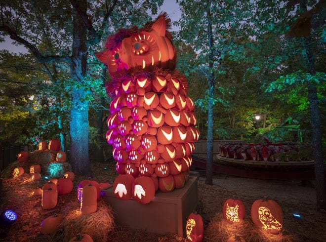 When the sun goes down, the pumpkins and friendly animal sculptures light up the streets of Silver Dollar City near Branson.