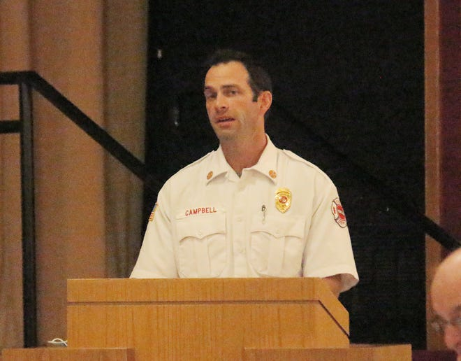 Pontiac Fire Chief Jacob Campbell updates the city council on the ambulance service at Monday's meeting at the Eagle Theater.