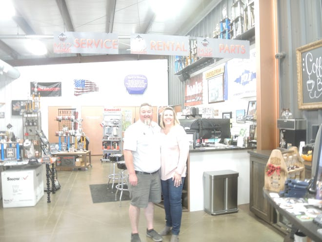 Ryan and Julie LaLone in the Diesel Freak shop on Milbocker Road in Gaylord. With all of their businesses growing,  the LaLones have broken ground on a $5.6 million facility on M-32 West next to the cinema complex.