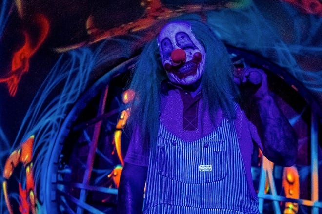 Pictured is a clown from Reaper's Revenge in Blakely, a haunted attraction featuring a spooky hayride and walks through terrifying houses.
