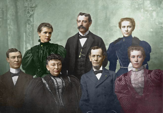 In this picture circa 1890, Major Nathan Smith Boynton sits in a blue suit. Next to him in black is his wife Annie Boynton, and next to her is George Boynton. Anna Boynton is standing and wearing green, and next to her is her brother Charles Lincoln Boynton. In blue is Frances Boynton. In red is Edith Boynton.