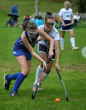 Cumberland's Katelyn Blais and Burrillville's Marley Ducharme race to the ball during second-half action Tuesday in Burrillville.