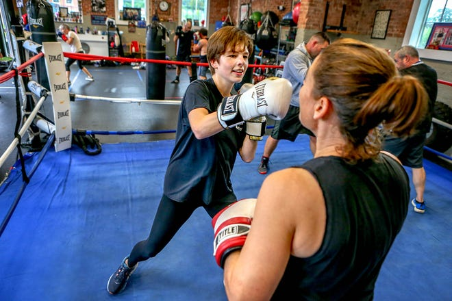 Reporter Amy Russo, left, spars with Amy Cham, co-owner and lead fitness coach at On the Ropes Boxing and Fitness in Warwick