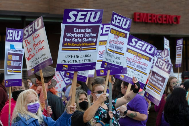 Health care workers at McKenzie-Willamette Medical Center in Springfield walk a picket line outside the hospital after calling for a strike Tuesday.