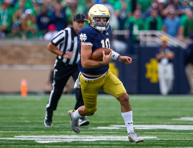 Notre Dame's Drew Pyne (10) runs the ball during the Notre Dame vs. Cincinnati NCAA football game Saturday, Oct. 2, 2021, at Notre Dame Stadium in South Bend.