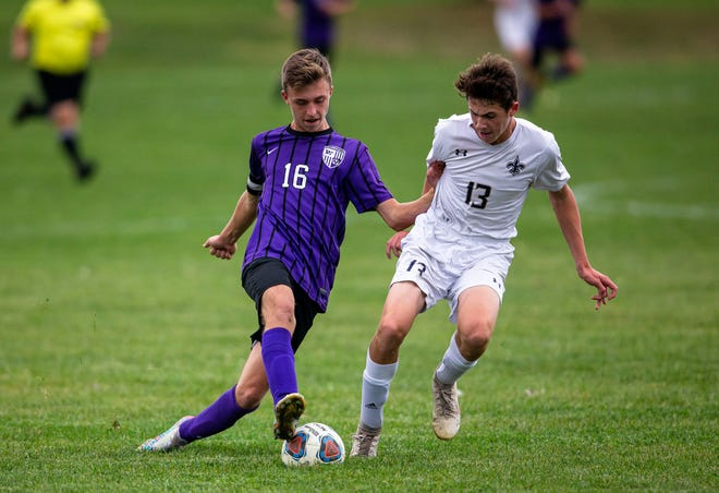 Williamsville's Cameron Frye (16) tries to move the ball past Bloomington Central Catholic's Jarrett Wieduwilt (13) in the first half at Williamsville High School in Williamsville, Ill., Monday, October 4, 2021. [Justin L. Fowler/The State Journal-Register]