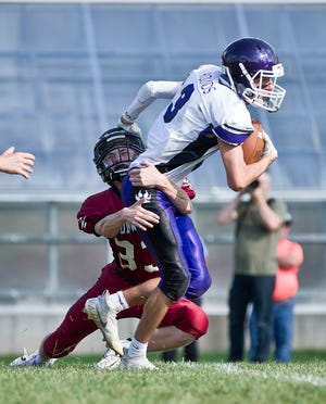 Pickford's Braylon Rounds tries to break free from a tackle by Ironwood's Gavin Rubatt Saturday at Longyear Field in Ironwood.
