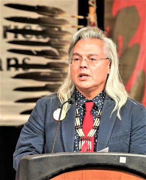 Dr. Aaron Payment speaking at the podium at a previous National Congress of American Indians meeting.