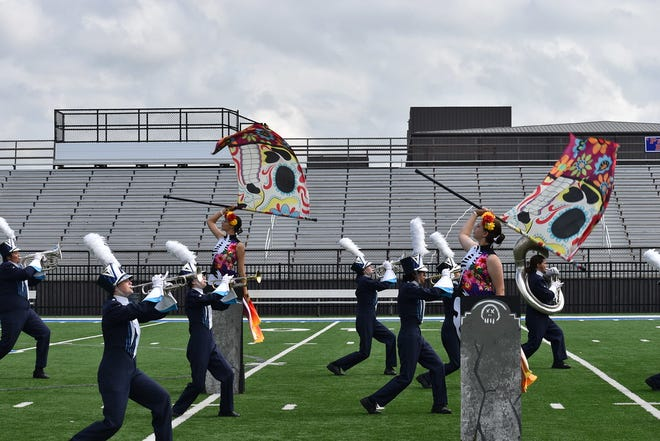 Shawnee High School Marching Band students perform at their competition Saturday in Bixby.
