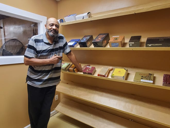 Kenneth Moulton stands in the humidor room at his new cigar lounge on Glenburnie Road