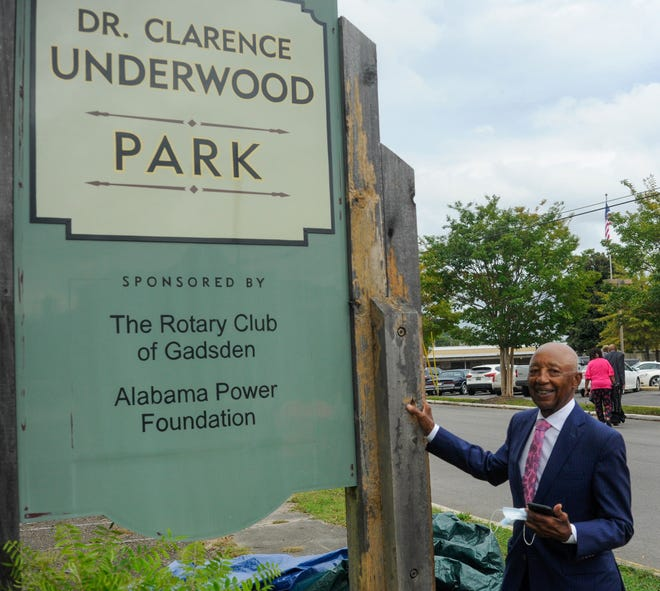 Dr. Clarence Underwood Jr. stands next to the new sign that renames the park across from the Gadsden Library after him on Tuesday, Oct. 5, 2021, in Gadsden, Alabama.