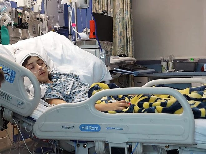 """This photo of Bowerston's Kaleb Grezlik, 13,  was taken Satuday. """"This morning Kaleb is feeling horrible and looks about the same. He is having a reaction to the platelet transfusions he received. He is still listed as critical. He is on oxygen full time since yesterday,"""" his mother Cortney Grezlik wrote on Facebook."""