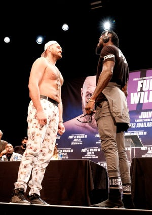 WBC Heavyweight Champion Tyson Fury, left and Deontay Wilder face off at a news conference in Los Angeles on Tuesday, June 15, 2021, in anticipation of their third heavyweight championship showdown scheduled for July 24 in Las Vegas.
