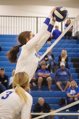 Sammy Moore with a block at the net in the game against Aubrey.