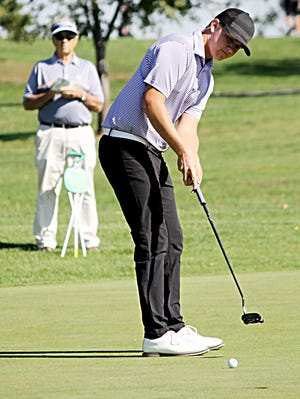 Watertown sophomore Jake Olson, shown attempting a putt on the No. 3 hole at the Broadland Creek Golf Course in Huron, shot an even-par Tuesday to nail down the individual championship in the state Class AA high school boys golf tournament. Olson helped lead the Arrows to a third-place finish in the two-day tourney.