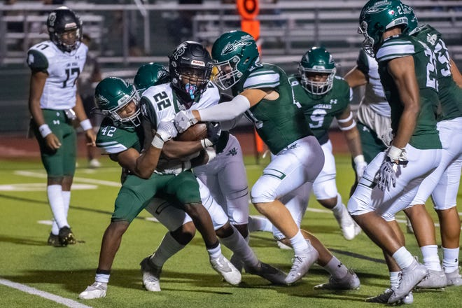 Waxahachie defenders swarm Mansfield Lake Ridge running back Marcus Hayes during the Indians' 30-21 victory at Lumpkins Stadium on Sept. 24. The Indians return from the district-wide bye week with a huge game at Cedar Hill this Friday night that carries major playoff seeding implications.