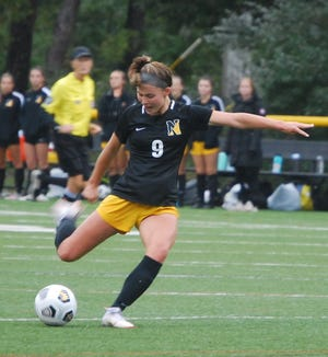Nauset forward Caroline Kennard connects for a first half goal against Barnstable on Tuesday afternoon.