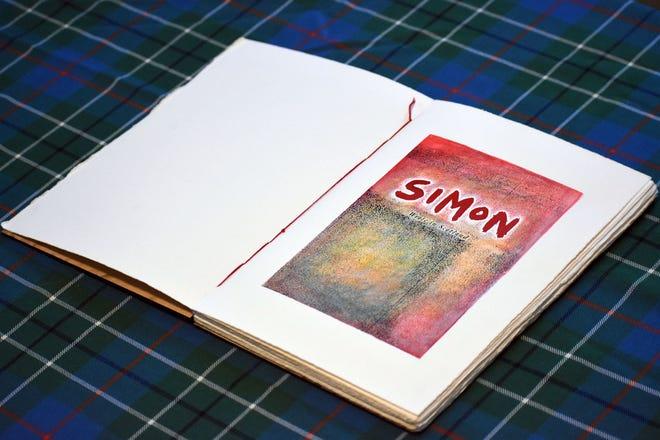 """Simon: Wrote in Scotland,"" artist book: tartan, mdf, ink on paper"