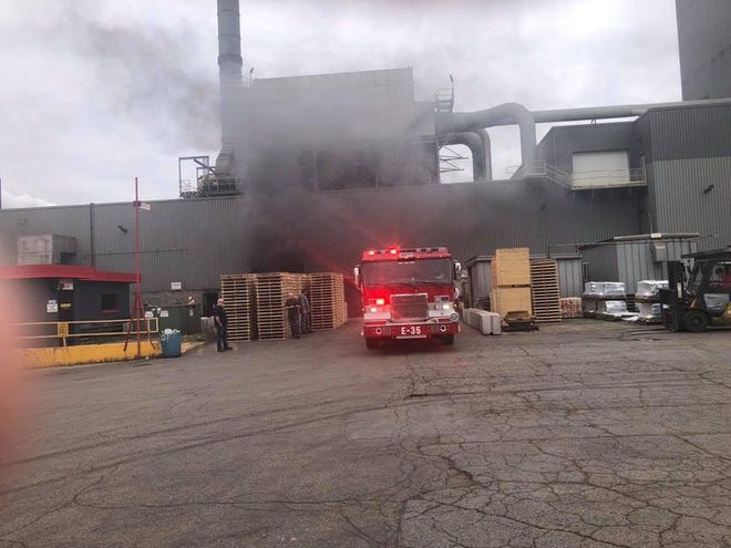 Firefighters battle a fire at Neenah Foundry on Tuesday morning.