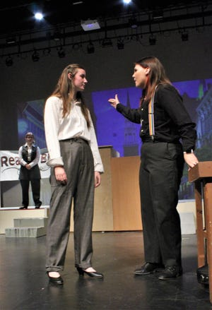"""Defense attorney Drummond (Samantha Connelly, right) makes her point to prosecutor Brady (Karissa Ward) in this rehearsal scene from """"Inherit the Wind,"""" Abilene High School's fall drama on stage this weekend."""