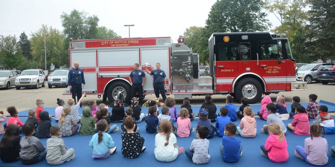 Battle Creek Lt. Andre Doser, from left,  Firefighters Shaun Kelly and Gus Furman begin their presentation for Fire Prevention Week at Valley View Elementary on Tuesday.