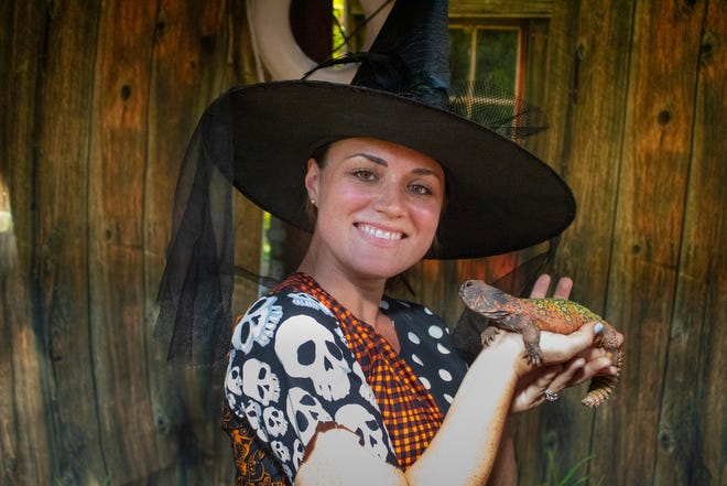 """Amanda Sanford from Brevard Zoo and her SbF(scaly best friend) enjoy """"Boo at the Zoo,"""" presented by Avtec Homes."""