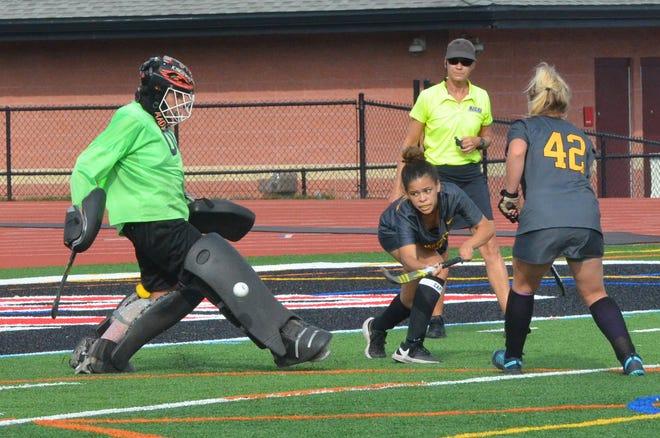 Kingsway senior Madison Ferry kicks away a shot by Moorestown senior Samantha Miller as Sydney Kowalczyk closes in