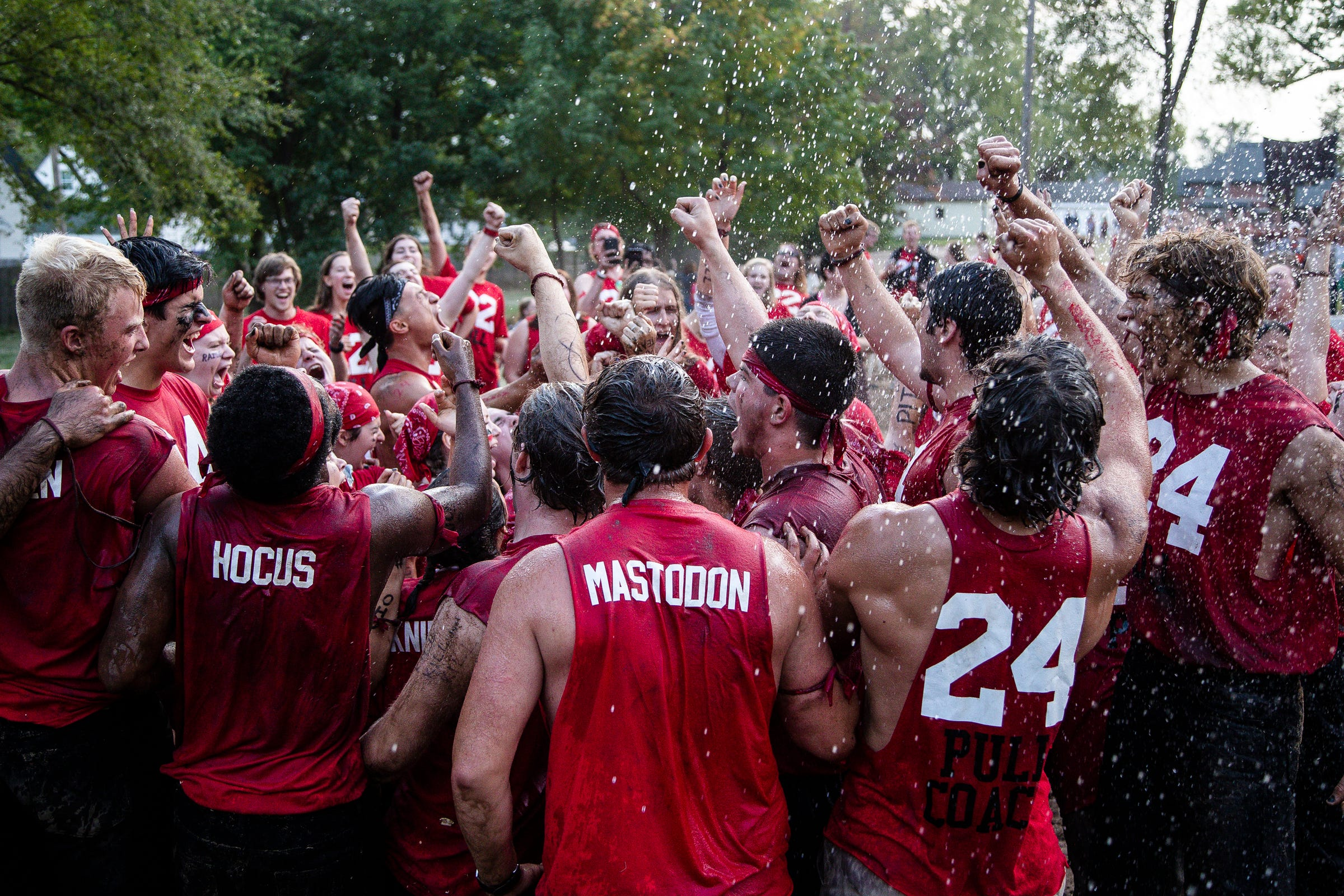 Members of the even year pull team celebrate their win over the odd year team during The Pull, an annual tug-of-war between the freshman and sophomore classes at Hope College in Holland on Saturday, Oct. 2, 2021.