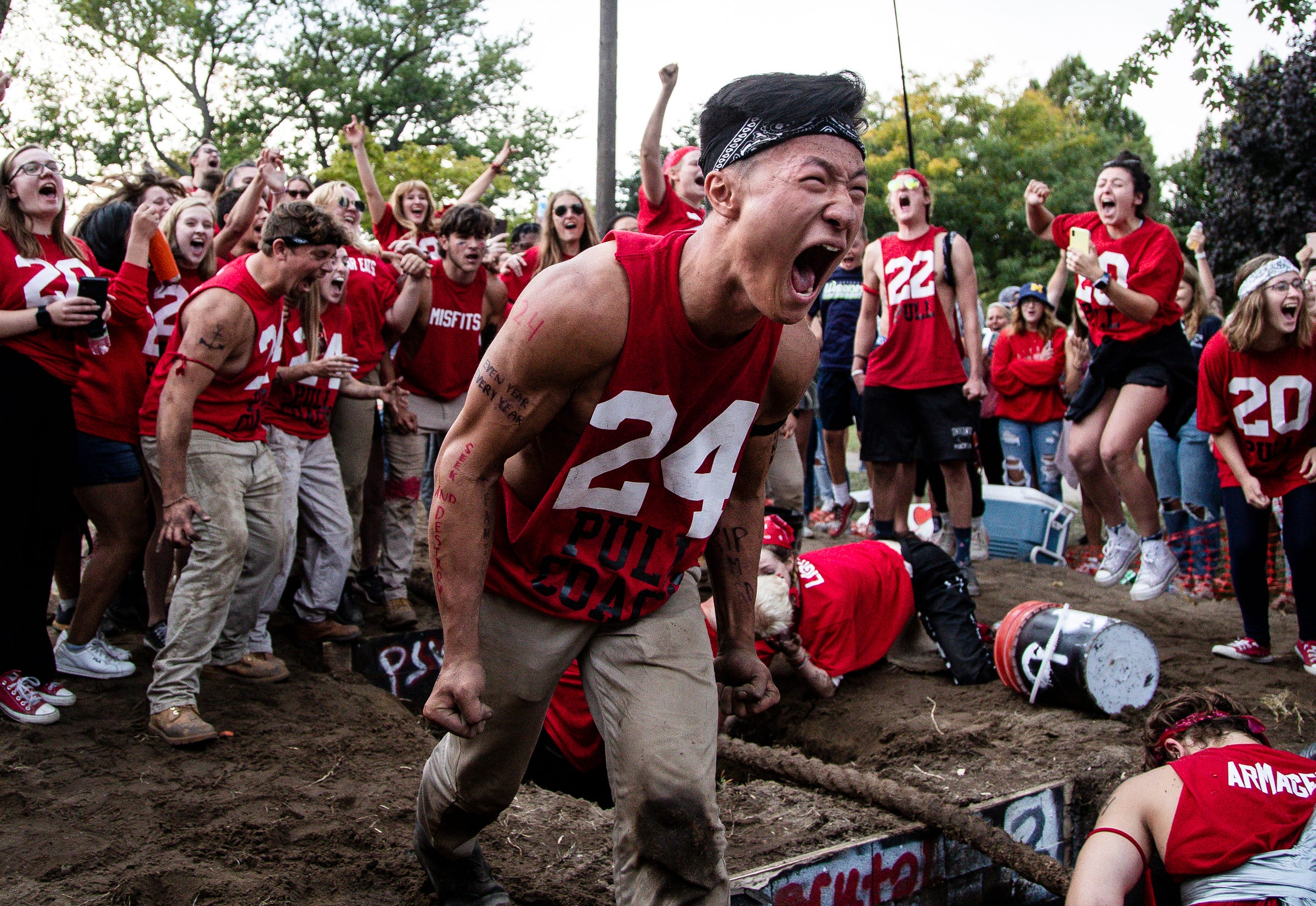 Ryan Baek, an even year team pull coach celebrates as the team reacts to winning this year's The Pull, an annual tug-of-war between the freshman and sophomore classes at Hope College in Holland on Saturday, Oct. 2, 2021.