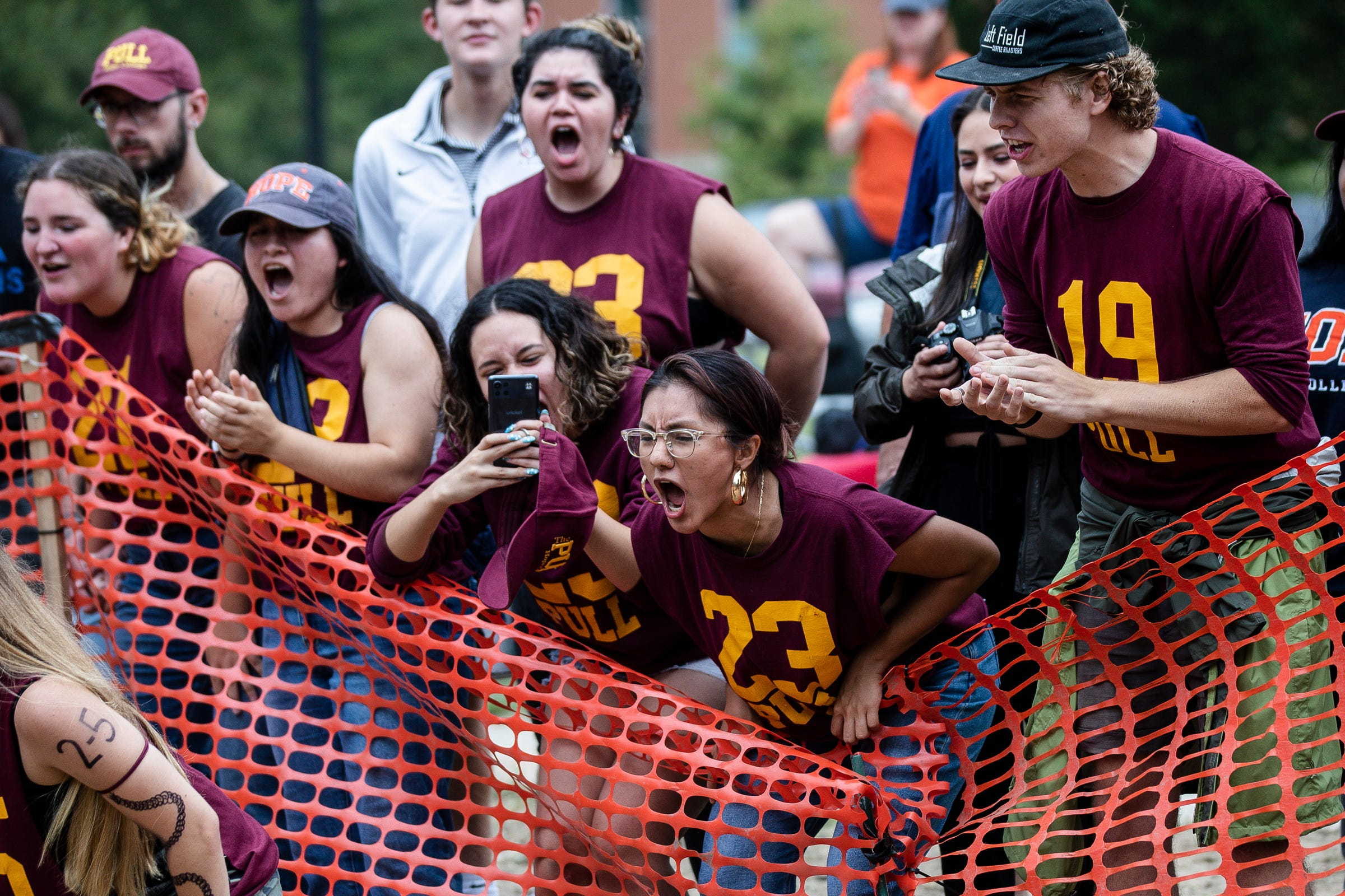 Odd year students and alumni cheer for the freshmen team the Pull, an annual tug-of-war between the freshmen and sophomore  classes at Hope College in Holland on Saturday, Oct. 2, 2021.