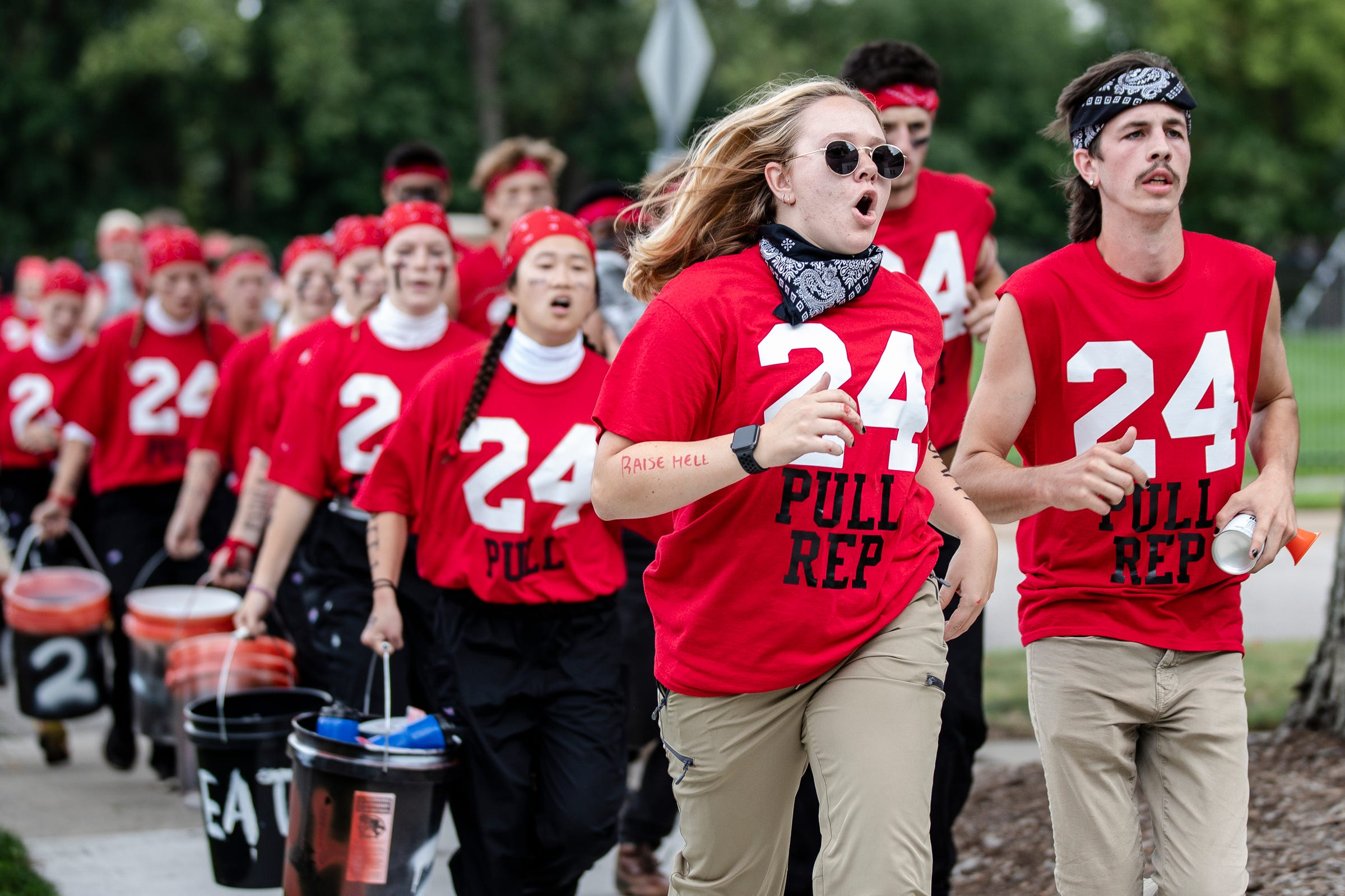 Members of the even year pull team led by representatives Ellie Margason, center, and Cole Manilla, right, arrive for the Pull, an annual tug-of-war between the freshmen and sophomore classes at Hope College in Holland on Saturday, Oct. 2, 2021.