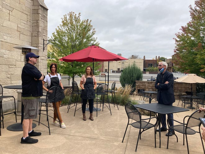 Gov. Evers talked with the owners of The Cellar District about their new restaurant inside the former Immanuel Trinity Lutheran Church. From right, owners Sarah Palas and Brandee Alexander, and Chef Dean, discuss their locally-sourced menu.