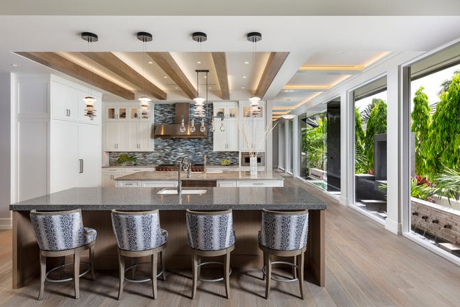 A second island was added to the kitchen, new flooring was put in. The biggest renovation to the kitchen was the removal of a column. That opened the room up more to the living room area in this great room.