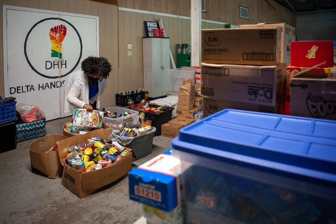 Chiquikta Fountain, executive Director of Delta Hands for Hope, organizes food donations in Shaw, Miss., on Sept. 23, 2021.