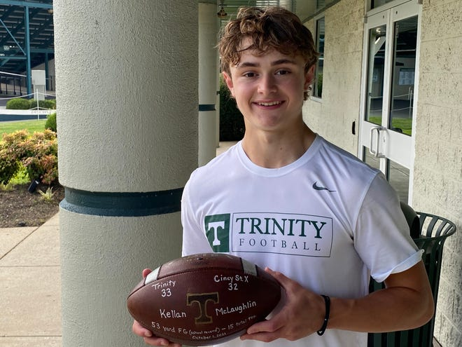 Trinity junior kicker Kellan McLaughlin poses holding the game ball of Trinity's 33-32 win over St. Xavier (Cincinnati) on Oct. 4 2021.