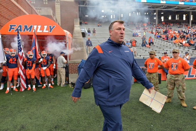 Oct 2, 2021; Champaign, Illinois, USA;  Illinois Fighting Illini head coach Bret Bielema walks onto the field before his team's game with the Charlotte 49ers at Memorial Stadium.  Mandatory Credit: Ron Johnson-USA TODAY Sports