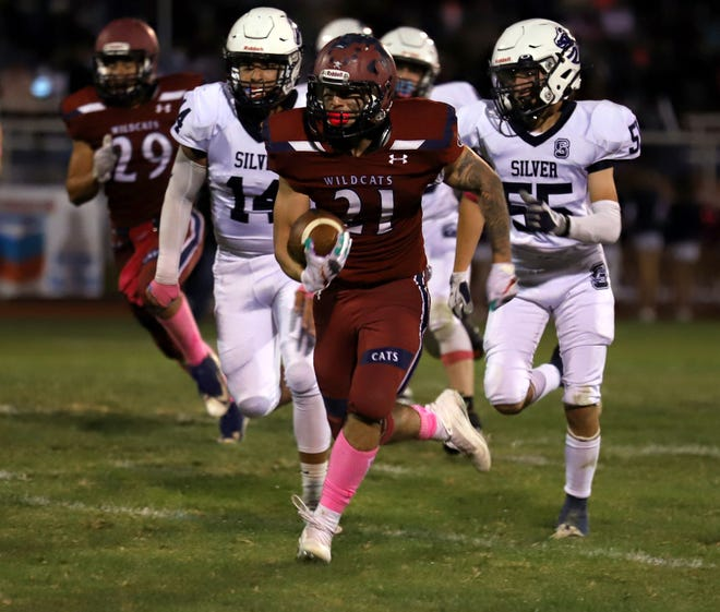 Silver High defenders found themselves in Joey Reza's (21) rear-view mirror during Friday's 28-6 Deming Wildcat victory at DHS Memorial Stadium. Reza scored four rushing touchdowns.