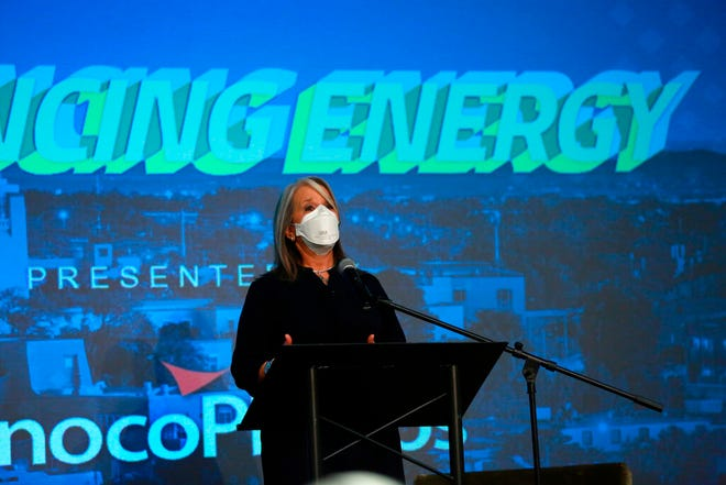 Democratic Gov. Michelle Lujan Grisham addresses energy executives at the New Mexico Oil And Gas Association meeting on Monday, Oct. 4, 2021, in Santa Fe. Lujan Grisham has moved to crack down on pollution from gas extraction while also trying to shield the state's producers from a drilling moratorium by the Biden administration. New Mexico relies on oil and gas royalties for around one-third of its budget.