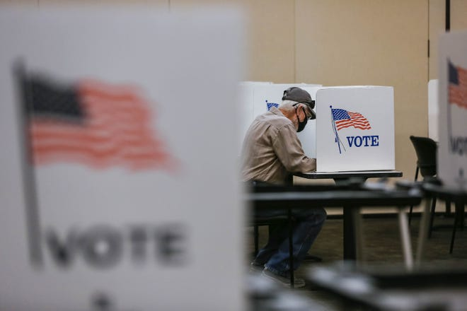 George Baird casts a ballot at the first day of early voting at the the Doña Ana County Government Center in Las Cruces on Tuesday, Oct. 5, 2021.