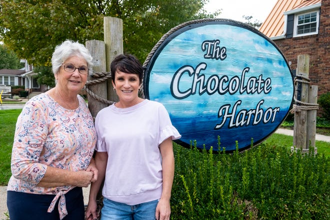Mary Vargo and daughter Darci Vargo-McGuire, owners of The Chocolate Harbor in St. Clair, pose for a portrait Tuesday, Oct. 5, 2021, outside the store. After operating it for over 25 years the two are retiring.