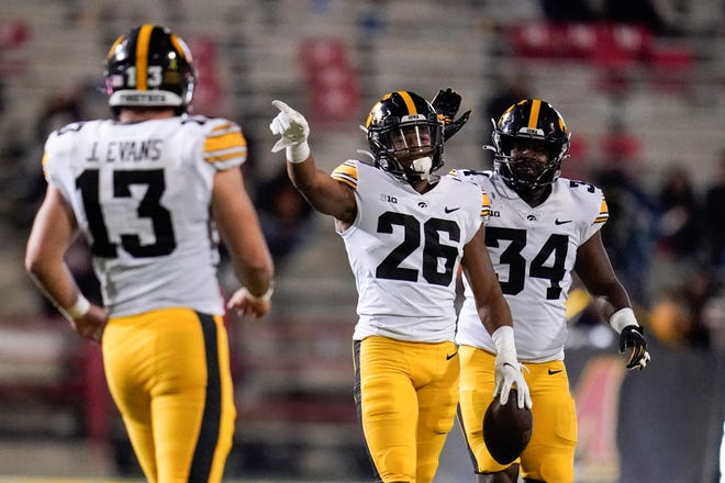 Iowa defensive back Kaevon Merriweather (26) reacts after making an interception against Maryland on Friday night. The Hawkeyes already have 12 interceptions this season.