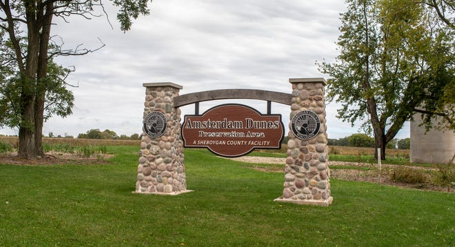 A sign marks Amsterdam Dunes Preservation Area, Tuesday, October 5, 2021, in Sheboygan, Wis.