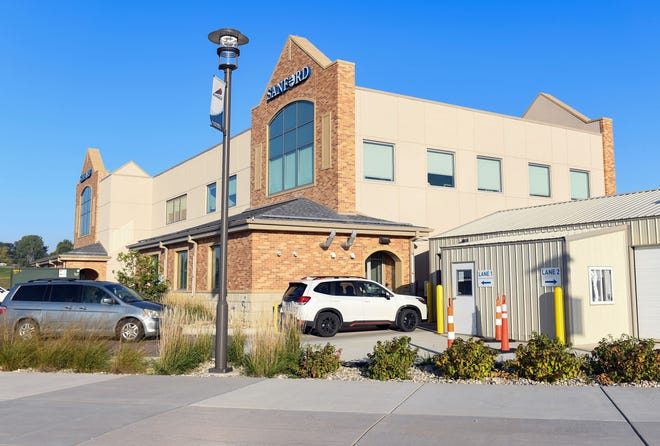 People stop by the drive-thru COVID-19 test site on Tuesday, October 5, 2021, outside the Sanford Sports Complex Acute Care clinic in northern Sioux Falls.