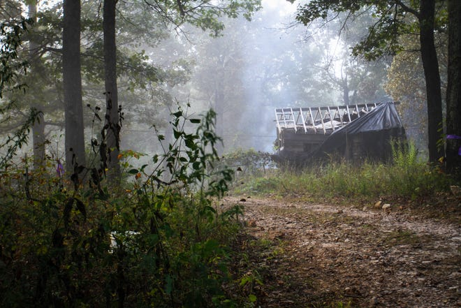 Smoke and fog mingle at the property where James Phelps' home stood before a fire destroyed it Monday, Oct. 4, 2021.